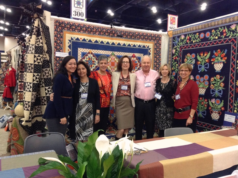 (L. to R.) Mechelle, Indra, Regina, Laura, Jan, Pati and Stephanie are ready to serve as Quilt Market officially opened on October 27.